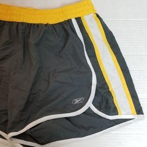 REEBOK grey and yellow stripe running shorts